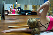 Physical therapist Beth Janssen instructs Tylene Dierickx, 15, on exercise to correct scoliosis. (Photo © Andy Manis)