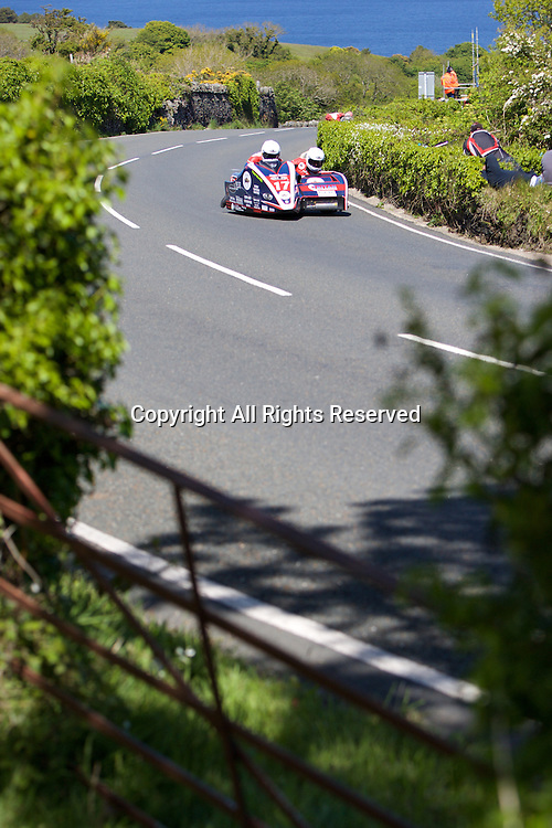 08.06.2015. Douglas, Isle of Man. 2015 Isle of Man TT Races. Greg Lambert and Kenny Cole in action during the TT Sidecar race.