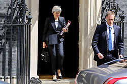 © Licensed to London News Pictures. 22/05/2019. London, UK. British Prime Minister Theresa May departs from Number 10 Downing Street to attend Prime Minister's Questions (PMQs) in the House of Commons. <br /> The Prime Minister announced on Tuesday 21 May, that the UK Government will include in the Withdrawal Agreement Bill a requirement to vote on a second referendum, to be put to a vote in the Commons in early June. Photo credit: Dinendra Haria/LNP