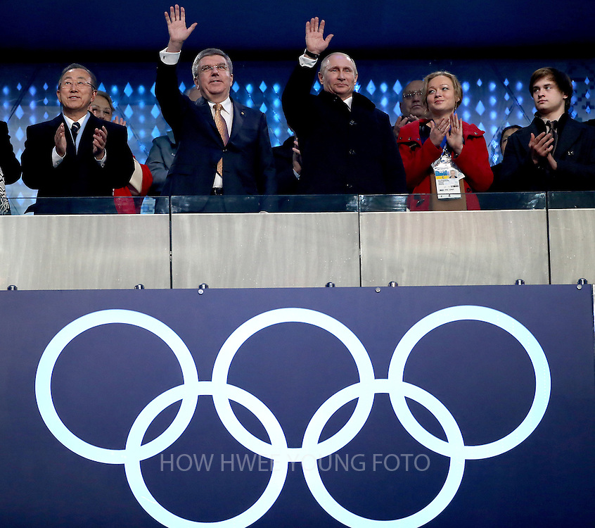 epa04060008 UN Secretary General Ban Ki-Moon (L), Russian President Vladimir Putin and IOC president Thomas Bach (C) during the Opening Ceremony of the Sochi 2014 Olympic Games at the Fisht Olympic Stadium, Sochi, Russia, 07 February 2014.  EPA/HOW HWEE YOUNG