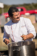 Chef Alejandro Ruiz of Casa Oaxaca prepares a meal during Cook it Raw outdoor BBQ event on Bowen's Island October 26, 2013 in Charleston, SC.
