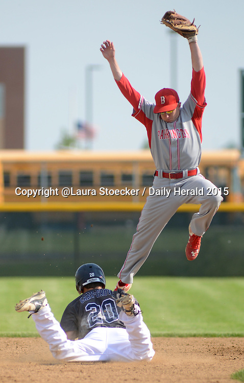 Laura Stoecker/lstoecker@dailyherald.com<br /> Cary-Grove's Matt Sutherland is safe back on second base as Barrington's Andrew Stopka leaps to catch the ball as well as leap out of his way in the first inning of the Class 4A Jacobs regional semifinal at Jacobs High School Thursday.