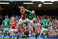 Ireland's Brian O'Driscoll jumps for a high ball with George North of Wales. RBS Six nations championship, Wales v Ireland at the Millennium stadium in Cardiff, South Wales on Saturday 2nd Feb 2013. pic by Andrew Orchard, Andrew Orchard sports photography,