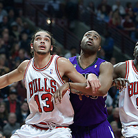 21 December 2009: Chicago Bulls center Joakim Noah and Luol Deng box out Kenny Thomas #9 of the Sacramento Kings during the Sacramento Kings 102-98 victory over the Chicago Bulls at the United Center, in Chicago, Illinois, USA.