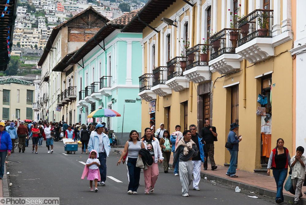 People stroll a street in Quito, Ecuador, Pichincha province, South America. San Francisco de Quito is most often called Quito, capital city of Ecuador and of Pichincha province. This city of 1.4 million people (as of the 2001 census) is located in the Guayllabamba river basin, on the eastern slopes of Pichincha, an active stratovolcano in the Andes mountains. UNESCO honored City of Quito as a World Heritage Site in 1978. Quito was founded in 1534 on the ruins of an Inca city. Despite the 1917 earthquake, the city has the best-preserved, least altered historic center in Latin America. In 2008 the city was designated as the headquarters of the Union of South American Nations. The elevation of the city's central square (Plaza de La Independencia or Plaza Grande) is 2850 meters (9350 feet), making Quito the second-highest administrative capital city in the world (after La Paz, Bolivia). The central square of Quito is located about 25 km (15 miles) south of the equator; the city itself extends to within about 1 km (0.6 miles) of zero latitude. A monument and museum marking the general location of the equator is known locally as la mitad del mundo (the middle of the world), to avoid confusion, as the word ecuador is Spanish for equator.