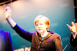 The half-Scottish governor of Lower Saxony, David McAllister and German Chancellor Angela Merkel during an election campaign event at Hildesheim, Germany held with the  half-Scottish governor of Lower Saxony, David McAllister..©Michael Schofield.