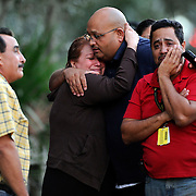 Members of a missing Rodgers Middle School girl embrace after learning that her body found in retention near the School Monday, Oct. 22, 2012 in Riverview. Jennifer Caballero had wondered off during school and an intense search was conducted but Hillsborough Sheriff's deputies later discovered her body in 12 ft. of water.