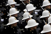 The white helmets of the Royal Marines who march through the City of London during the annual Lord Mayor's Show. The new Mayor's procession consists of a 3-mile, 150-float parade of commercial and military organisations going back to medieval times. This is the oldest and longest civic procession in the world that has survived the Plague and the Blitz, today one of the best-loved pageants. Henry Fitz-Ailwyn was the first Lord Mayor (1189-1212) and ever since, eminent city fathers (and one woman) have taken the role of the sovereign's representative in the City - London's ancient, self-governing financial district. The role ensured the King had an ally within the prosperous enclave.
