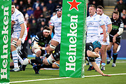Glasgow Warriors second row forward Scott Cummings (5) dives over for his try during the Heineken Champions Cup match between Glasgow Warriors and Cardiff Blues at Scotstoun Stadium, Glasgow, Scotland on 13 January 2019.