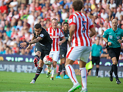 STOKE-ON-TRENT, ENGLAND - Sunday, August 9, 2015: Liverpool's Philippe Coutinho Correia scores the first goal against Stoke City during the Premier League match at the Britannia Stadium. (Pic by David Rawcliffe/Propaganda)
