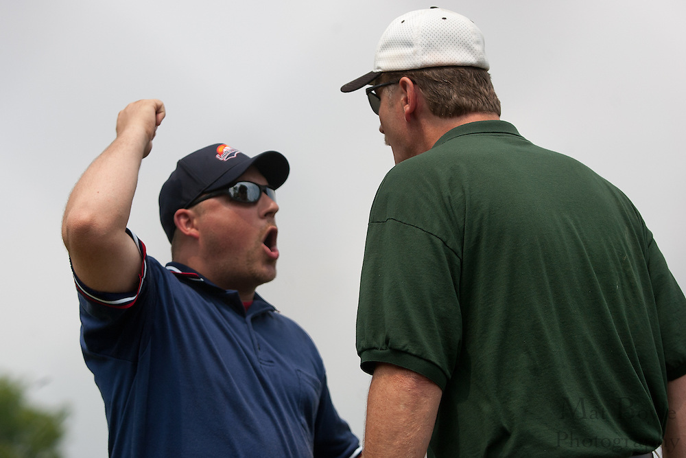West Deptford Coach Ed Essig gets thrown out of the game while arguing with an umpire after Tyler Strano got ejected during a elimination bracket game of the Eastern Regional Senior League tournament held in West Deptford on Sunday, August 7.
