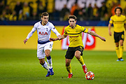 Tottenham Hotspur midfielder Harry Winks (8) tackles Borussia Dortmund defender Raphaël Guerreiro (13) during the Champions League round of 16, leg 2 of 2 match between Borussia Dortmund and Tottenham Hotspur at Signal Iduna Park, Dortmund, Germany on 5 March 2019.