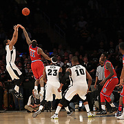 Josh Fortune, Providence, shoots a three pointer during the Providence Vs St. John's Red Storm basketball game during the Big East Conference Tournament at Madison Square Garden, New York, USA. 12th March 2014. Photo Tim Clayton