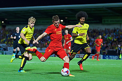 BURTON-UPON-TRENT, ENGLAND - Tuesday, August 23, 2016: Liverpool's James Milner sets-up the fourth goal against Burton Albion during the Football League Cup 2nd Round match at the Pirelli Stadium. (Pic by David Rawcliffe/Propaganda)