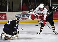 UNO forward Kyle O'Keefe gets kocked down as his his shot  bounces off Minnesota State Mankato goalie  Jon Volp.<br /> (photo by Chris Machian/Prairie Pixel Group)