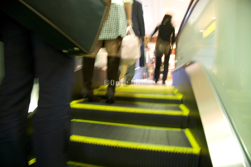 people going up an escalator
