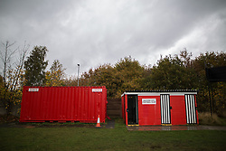 © Licensed to London News Pictures . 06/11/2015 . Salford , UK . Entrance turnstile and toilets in a container . TV crews and volunteers at the club set up for the FA Cup match between Salford City FC and visitors Notts County , at the club's Moor Lane ground . Photo credit : Joel Goodman/LNP
