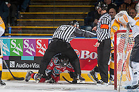KELOWNA, CANADA - DECEMBER 3: Conner Bruggen-Cate #20 of the Kelowna Rockets is protected by a linesman during second period against the Brandon Wheat Kings on December 3, 2016 at Prospera Place in Kelowna, British Columbia, Canada.  (Photo by Marissa Baecker/Shoot the Breeze)  *** Local Caption ***