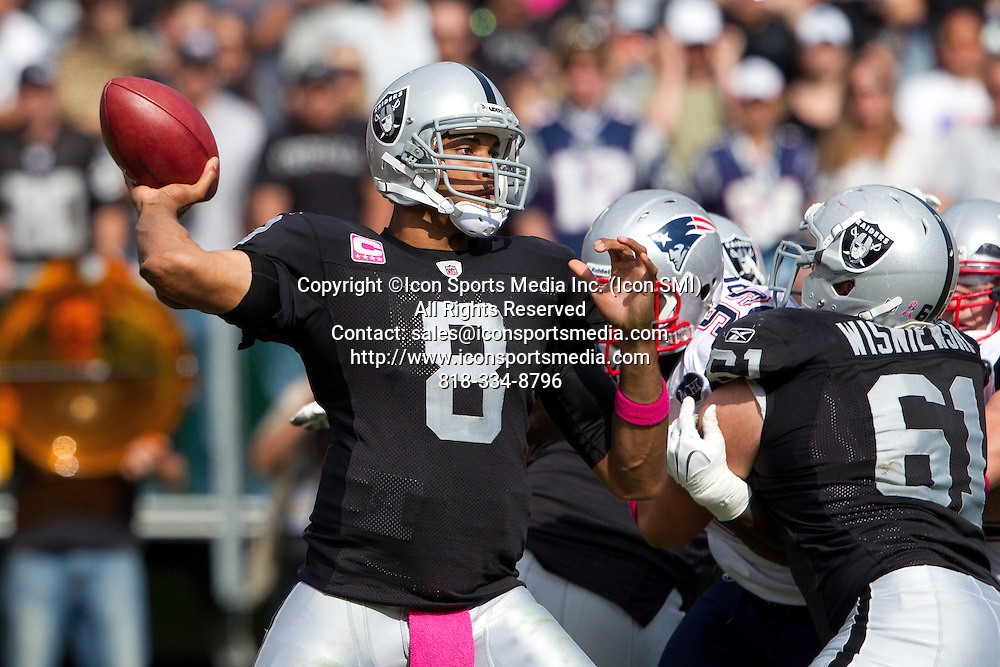 02 October 2011: Quarterback (8) Jason Campbell of the Oakland Raiders passes the ball against the New England Patriots during the second half of the Patriots 31-19 victory against the Raiders in an NFL football game at O.co Stadium in Oakland, CA.