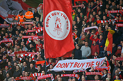 LIVERPOOL, ENGLAND - Saturday, February 6, 2010: Liverpool supporters with banners urging fans to boycott the Sun newspaper during the Premiership match at Anfield. The 213th Merseyside Derby. (Photo by: David Rawcliffe/Propaganda)