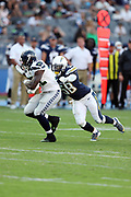 Los Angeles Chargers rookie linebacker Nigel Harris (58) chases Seattle Seahawks running back Chris Carson (32) from behind as Carson runs for a 10 yard second quarter gain during the 2017 NFL week 1 preseason football game against the against the Los Angeles Chargers, Sunday, Aug. 13, 2017 in Carson, Calif. The Seahawks won the game 48-17. (©Paul Anthony Spinelli)