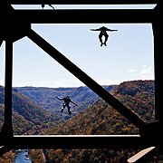 Bridge Day 2010, base jumpers brave the New River Gorge Bridge in West Virginia leaping 876 ft. from the bridge into the river below on October 15th 2010.