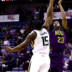 Feb 8, 2017; New Orleans, LA, USA; New Orleans Pelicans forward Anthony Davis (23) shoots over Utah Jazz forward Derrick Favors (15) during the first quarter of a game at the Smoothie King Center. Mandatory Credit: Derick E. Hingle-USA TODAY Sports