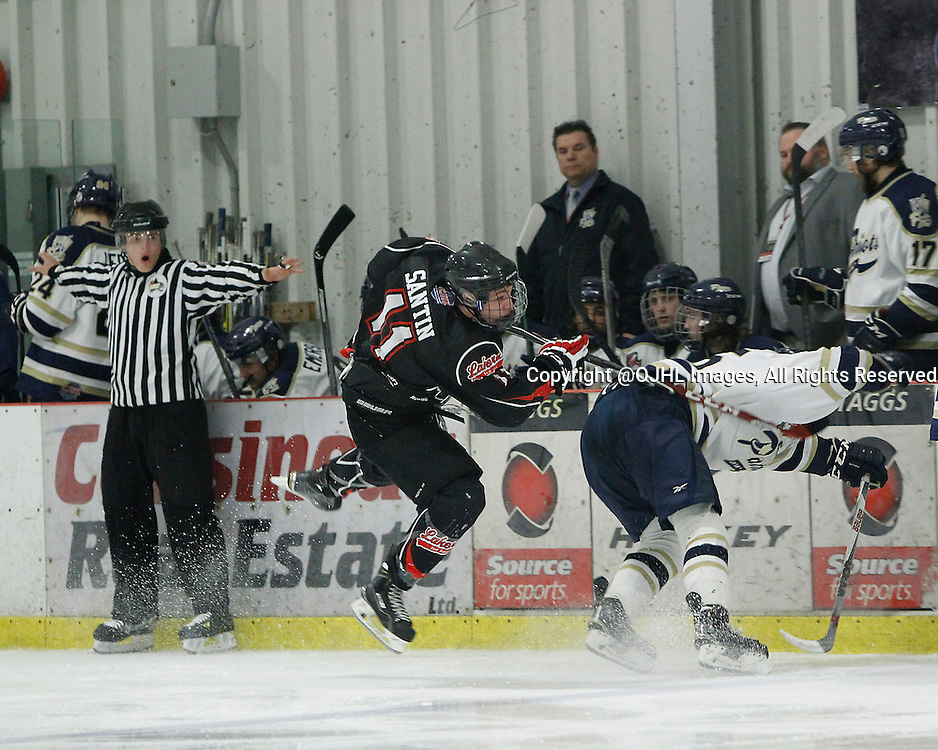 FORT FRANCES, ON - May 1, 2015 : Central Canadian Junior &quot;A&quot; Championship, game action between Fort Frances Lakers and the Toronto Patriots. Semi-Final game of the Dudley Hewitt Cup. Turner Santin #11 of the Fort Frances Lakers makes the hit in the third period.<br /> (Photo by Tim Bates / OJHL Images)