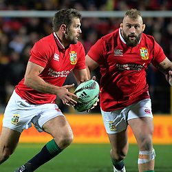 Jared Payne runs past Joe Marler during the 2017 DHL Lions Series rugby union match between the NZ Maori and British & Irish Lions at FMG Stadium in Hamilton, New Zealand on Tuesday, 20 June 2017. Photo: Dave Lintott / lintottphoto.co.nz