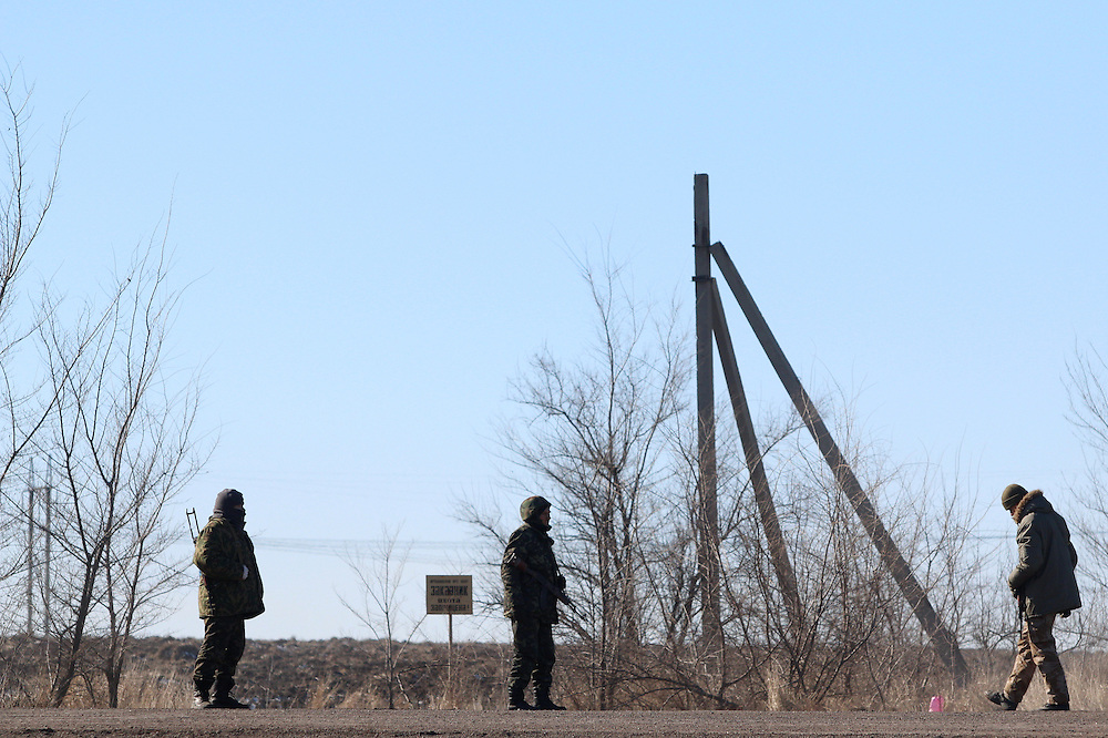 Soldier man a checkpoint on February 18, 2015 on a road about 30 kilometers from Debaltseve, Ukraine. Wednesday saw a steady stream of vehicles leaving the embattled city, which had apparently fallen to separatist forces.