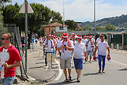 Poland fans arrive before the Euro 2016 match between Poland and Northern Ireland at the Stade de Nice, Nice, France on 12 June 2016. Photo by Phil Duncan.