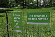 Signage in Central Park: Lawn open 9am to dusk; No organized sports allowed.