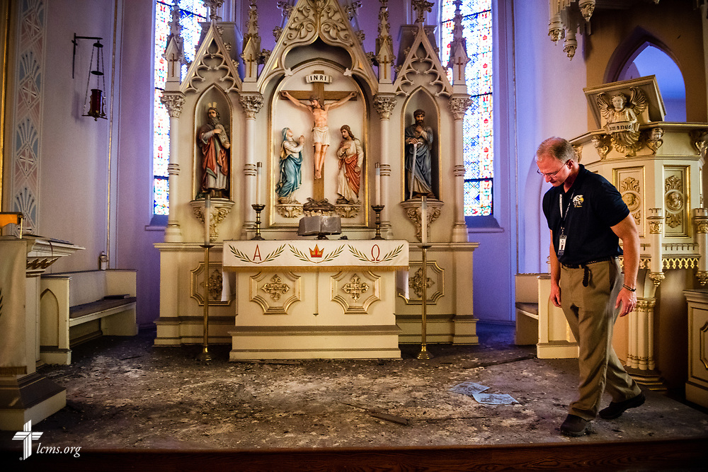The Rev. Scott Schmieding, senior pastor at Immanuel Lutheran Church, St. Charles, Mo., surveys the church's altar on Monday, June 4, 2018. The entire baptismal side of the sanctuary interior ceiling collapsed May 29 at 1.29 a.m. in the morning. No one was injured in the collapse, nor was the altar. LCMS Communications/Erik M. Lunsford