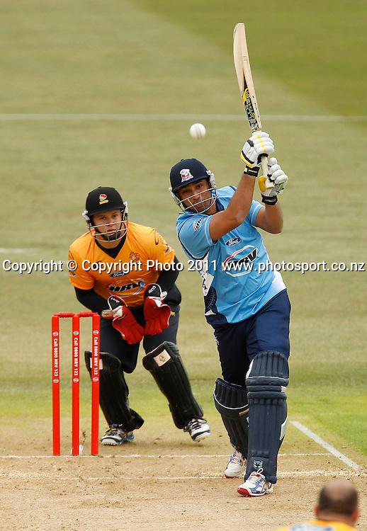 Ahzar Mahmood of the Aces bats during the HRV Cup Cricket Twenty-20,  Auckland Aces v Wellington Firebirds, Colin Maiden Park Auckland, Sunday 18 December 2011. Photo: Simon Watts/www.photosport.co.nz
