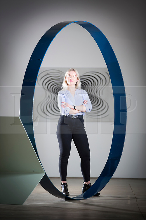 © Licensed to London News Pictures. 29/03/2017. Wakefield UK. Millie Carroll looks at the art work by David Annesley called Blue Ring which is part of the Kaleidoscope exhibition at Yorkshire Sculpture Park. The Yorkshire Sculpture Park has two new exhibitions drawn from the Arts Council Collection. The Re-Construct exhibit featuring Cornelia Parker & Alex Chinneck & the Kaleidoscope exhibition, a new Arts Council Collection touring exhibition. Photo credit: Andrew McCaren/LNP