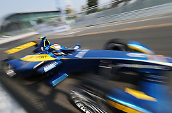 epa04398332 Swiss driver Sebastian Buemi of E. Adams Renault Formula E team in action during the FIA Formula E Championship racing series at the Olympic Park in Beijing, China, 13 September 2014. The first Formula E race takes place in Beijing 13 September using cars powered only by electricity.  EPA/HOW HWEE YOUNG