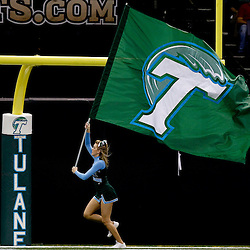 Sep 11, 2010; New Orleans, LA, USA; A Tulane Green Wave cheerleader carries a team flag following a score against the Mississippi Rebels during the second half at the Louisiana Superdome. The Mississippi Rebels defeated the Tulane Green Wave 27-13.  Mandatory Credit: Derick E. Hingle