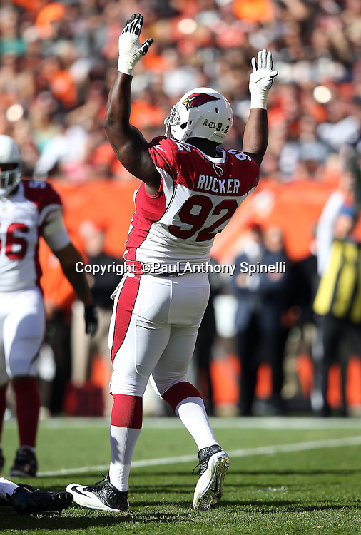 Arizona Cardinals defensive end Frostee Rucker (92) raises his arms in celebration during the 2015 week 8 regular season NFL football game against the Cleveland Browns on Sunday, Nov. 1, 2015 in Cleveland. The Cardinals won the game 34-20. (©Paul Anthony Spinelli)