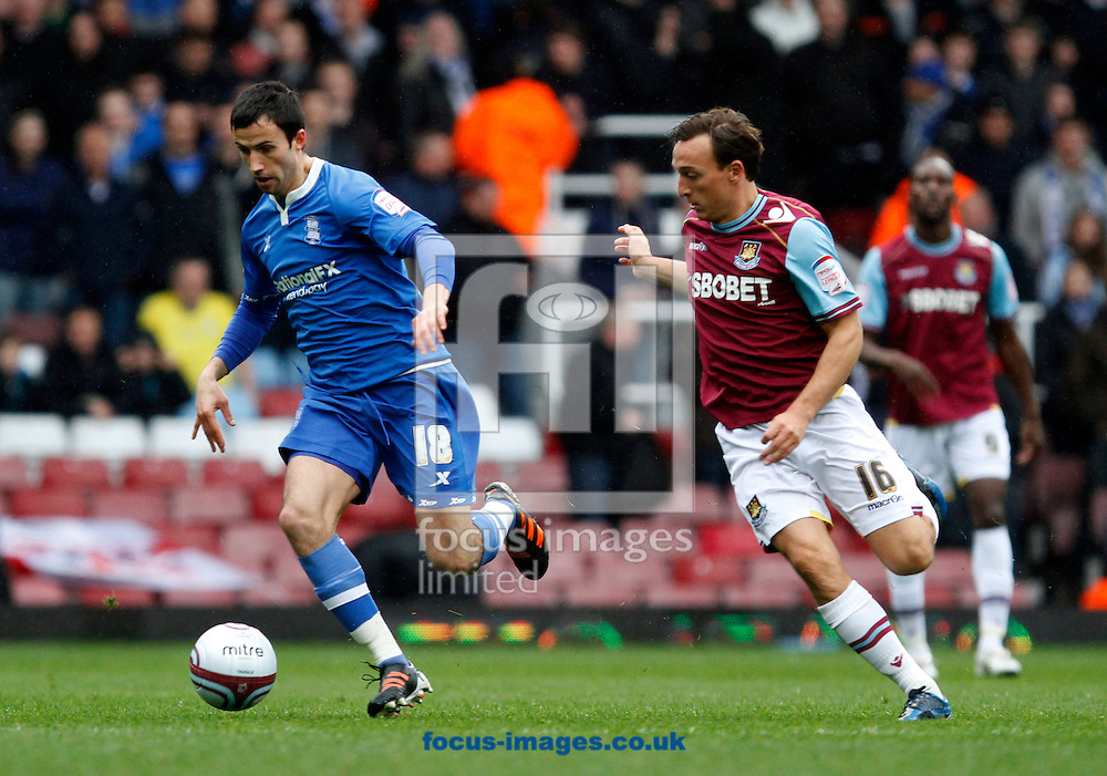 Picture by Daniel Chesterton/Focus Images Ltd. 07966 018899.09/04/12.Keith Fahey of Birmingham City and Mark Noble of West Ham during the Npower Championship match at the Boleyn Ground stadium, London.