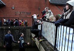 Competitors climb out of The River Dove - Mandatory byline: Robbie Stephenson/JMP - 09/02/2016 - FOOTBALL -  - Ashbourne, England - Up'Ards v Down'Ards - Royal Shrovetide Football