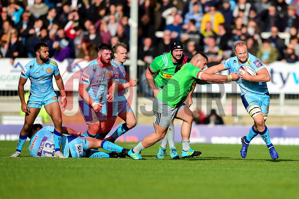 Tom Lawday of Exeter Chiefs is challenged by Archie White of Harlequins - Mandatory by-line: Ryan Hiscott/JMP - 10/11/2018 - RUGBY - Sandy Park Stadium - Exeter, England - Exeter Chiefs v Harlequins - Premiership Rugby Cup