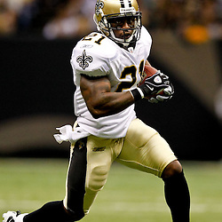 Oct 24, 2010; New Orleans, LA, USA; New Orleans Saints running back Julius Jones (21) runs during the first half against the Cleveland Browns at the Louisiana Superdome. Mandatory Credit: Derick E. Hingle