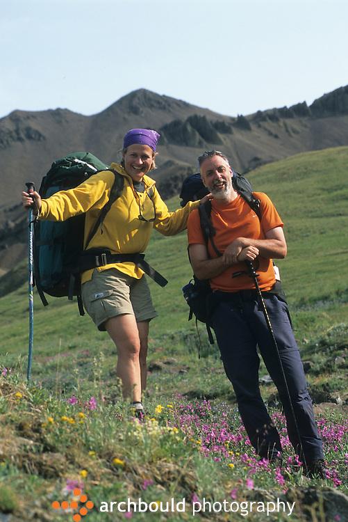 Back packing couple on Donjek Glacier hike in Kluane National Park, Yukon