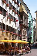 Tourists in pavement cafe in Herzog Friedrich Strasse, Innsbruck the Tyrol Austria
