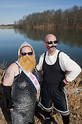 "Loralen Morgan (left) and Van Wright (right), of the ""Power 104 Subzero Heros"" pose for a portrait in their costumes during the Ohio University Polar Plunge. Morgan and Wright  was an entrant in the Polar Plunge costume contest, which was held before the plunge itself. Photo by: Ross Brinkerhoff."