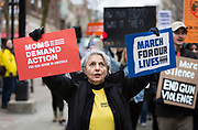 A protestor marches down State Street during the March for our Lives protest in Madison, Wisconsin, Saturday, March 24, 2018.
