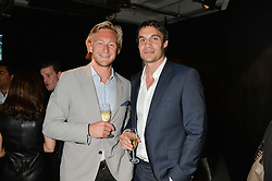 Left to right, OWAIN WALBYOFF and ADAM BIDWELL at the Audemars Piguet Royal Oak Offshore 42mm Party held at Victoria House, Bloomsbury Square, London on 23rd April 2014.