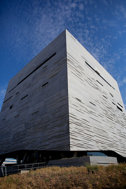 An exterior of  the Perot Museum of Nature and Science in Dallas, Texas.  The museum was designed by 2005 Pritzker Architecture Prize Laureate Thom Mayne and his firm Morphosis Architects.