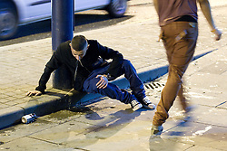 © Licensed to London News Pictures. FILE PICTURE DATED 01/01/2012. New Years Day revellers in Manchester. A young man vomits on the pavement. Please see special instructions for usage rates. Photo credit should read Joel Goodman/LNP