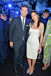 GIULIO PASTORE General Manager of Maserati Europe and YASMIN MILLS at the Maserati Levante VIP Launch party held at the Royal Horticultural Halls, Vincent Square, London on 26th May 2016.